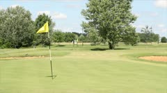 Golf course with yellow flag Stock Footage