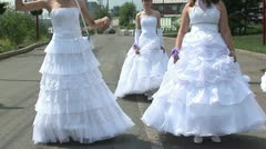 Brides are showing their dresses Stock Footage