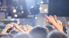 Crowd with smartphones and cameras at concert Stock Footage
