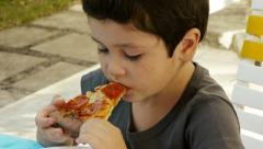 Boy Eating Pizza (HD) Stock Footage