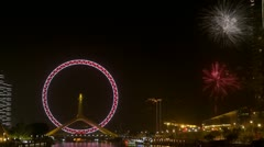 Timelapse Tianjin Eye and fireworks, Tianjin, China Stock Footage