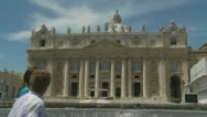 Tourists walk past St Peters (mid shot) Stock Footage