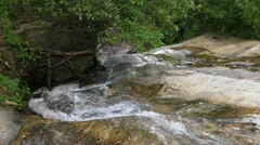 Stream flows over the Rocks - stock footage