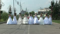 9 brides are turining around - stock footage