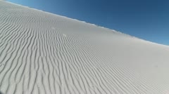 Hiker's Shadow Traverses Sand Dune Stock Footage
