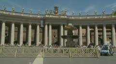 Police drive past St Peters Columns, Rome Stock Footage