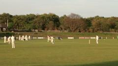Boys playing cricket Stock Footage