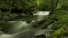Timelapse of blurred water in river with stunning surroundings Stock Footage