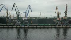 Port cranes loading coal Stock Footage