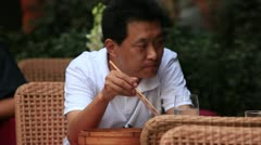 Shanghai Man Eating with Chopsticks - stock footage