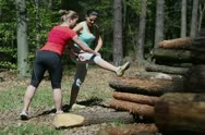 Two happy women exercising in the forest, steadycam Stock Footage