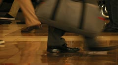 People walking in an airport concourse - stock footage