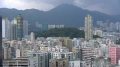 Clouds over HongKong buildings and hills in background till night fall Stock Footage
