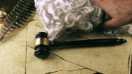 Stock Video Footage of Judge Places Robe Wig and Gavel (HD)