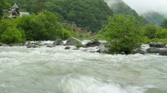 Raging waters of the mountain river during a typhoon.+sound. - stock footage