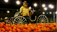 Stock Video Footage of Scarecrow, Pumpkins At Autumn Carnival Night