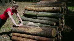 Young woman stretching in the forest, stedycam Stock Footage