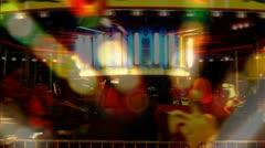 Stock Video Footage of Night Carnival Carousel Spinning Lights (SloMo)
