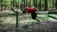 Young woman jogging and resting in the forest, steadycam, slow motion Stock Footage