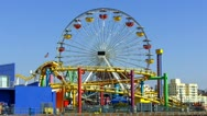 Stock Video Footage of Santa Monica Pier Ferris Wheel And Roller Coaster