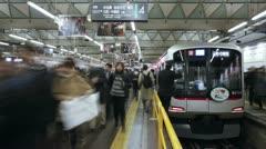 Japan, Tokyo, commuters T/L Stock Footage