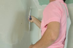 Plastering a Drywall Stock Footage
