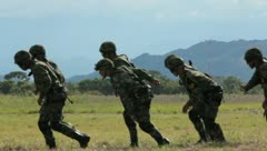 Soldiers getting on black hawk (HD)c  Stock Footage