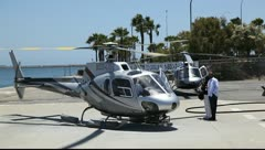 Tourists prepare to board helicopter - stock footage