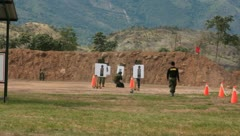 soldiers checking their accuracy at shooting range (HD)c  - stock footage