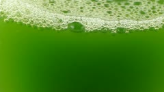 Foam & Blister on the surface of the water.A cup of green wort,wheat-juice,blis Stock Footage