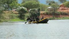 Men Paddling Raft across river (HD)m - stock footage