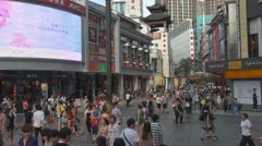 Tourists visit Dong Men Shopping District Shenzhen China neon sign video display - stock footage