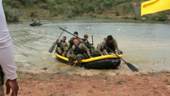 Soldiers doing water and life boat drills (HD)c Stock Footage