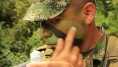 Man putting on camo paint (HD)m - stock footage
