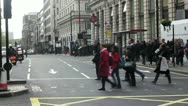 Busy London with Underground in distance and pedestrians Stock Footage