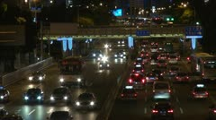 Heavy traffic night Shenzhen China aerial view freeway highway car pass - stock footage