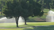 Stock Video Footage of Water Sprinklers Park Trees
