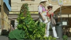 Little Italian boy looks at Green man in Rome Stock Footage