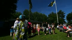 Traditional Swedish mid summer festivities - stock footage