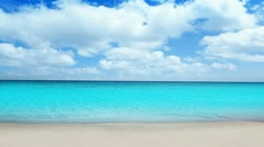 Idyllic tropical turquoise beach in caribbean sea with white sand shore - stock footage