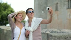 Happy female friends taking photo during summer holidays, outdoors HD Stock Footage