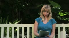 Woman Working on Tablet while Outside - stock footage