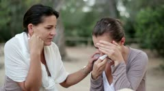 Young woman comforting tearful friend, outdoors HD Stock Footage