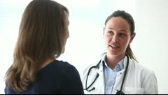 Doctor talks to patient - stock footage