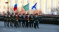 Military flag-bearers walks during parade - stock footage