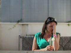 Sad woman sitting alone with exotic cocktail, dolly shot Stock Footage