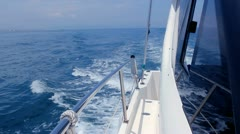Boating in blue sea on sport fisher boat side view from bow Stock Footage