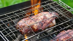 barbecue.chicken on the grill - stock footage