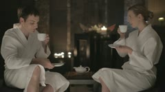 Man and woman drinking tea at the evening Stock Footage
