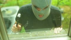 Burglar breaking entering alarm illegal burglary robber rob - stock footage